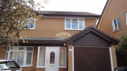 UPVC rosewood fascia white soffits brown round guttering