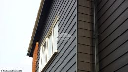 Black hardieplank cladding, black ash fascias and soffits black replacement guttering