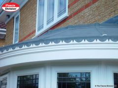 Curved decorative fascia on a large bay window