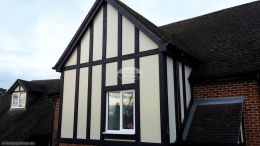 Replica oak mock tudor beams with cream render board installation