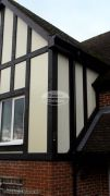 Replica Wood mock tudor beams with cream render board installation