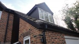 Black ash cladding replacement fascias soffits and guttering