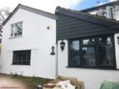 Anthracite fascias with Hardieplank cladding