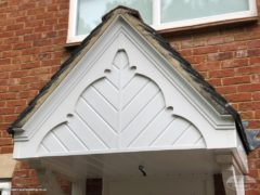 Decorative fascia with herringbone cladding on a porch